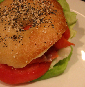 Smoked salmon cream cheese tomato and lettuce on bagel
