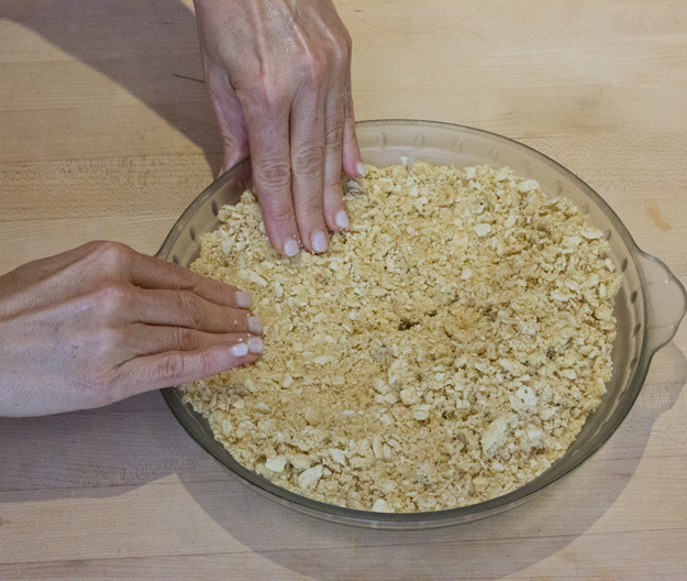 pressing crust into pie plate