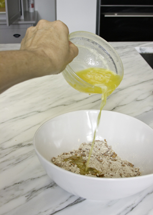 adding melted butter to crust