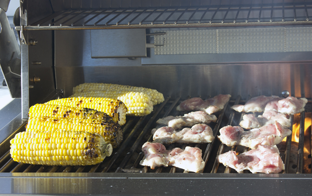 grilling chicken and corn