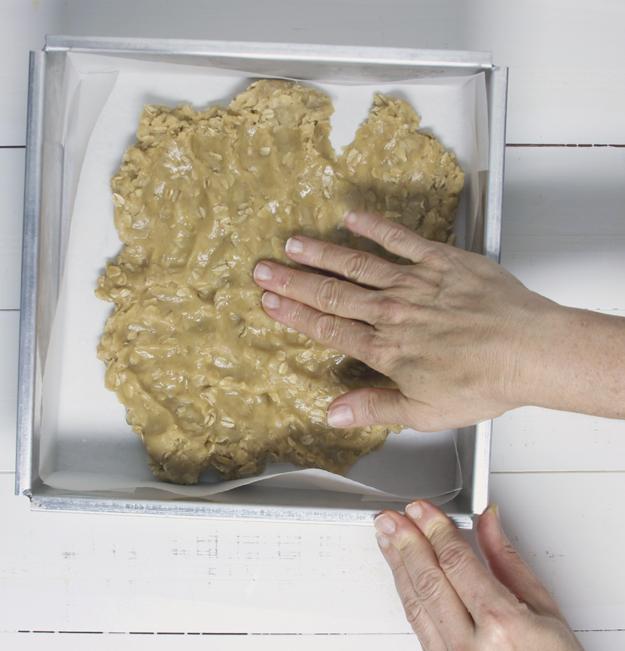 pressing base into pan