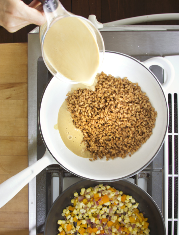 adding corn puree to farro