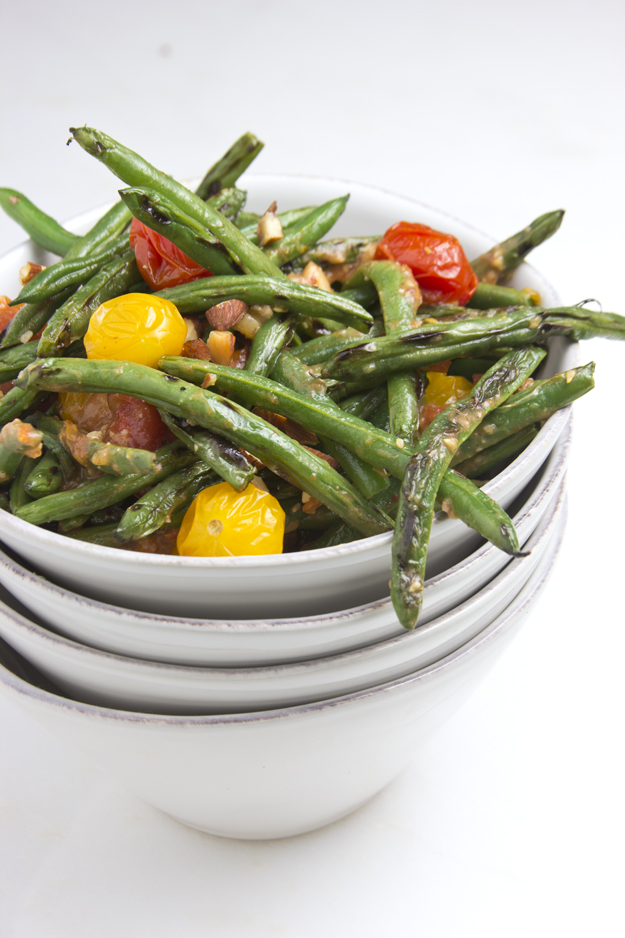 blistered green beans in a stack of bowls