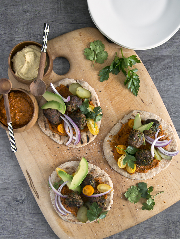 pitas on wooden cutting board