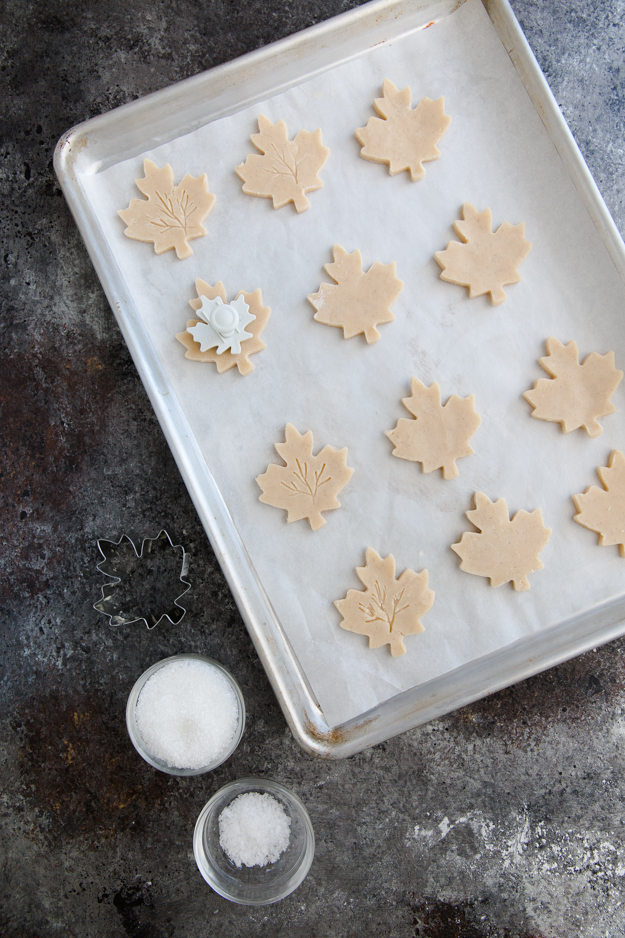 cookies on baking sheet with fondant tool